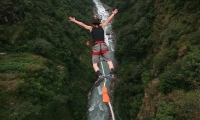 bungee jumper falling from cliff